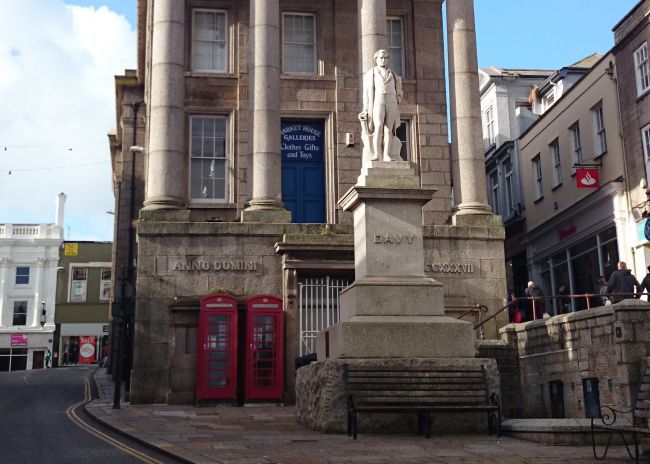 Humphry Davy statue and Lloyd's Bank on Market Jew Street in Penzance