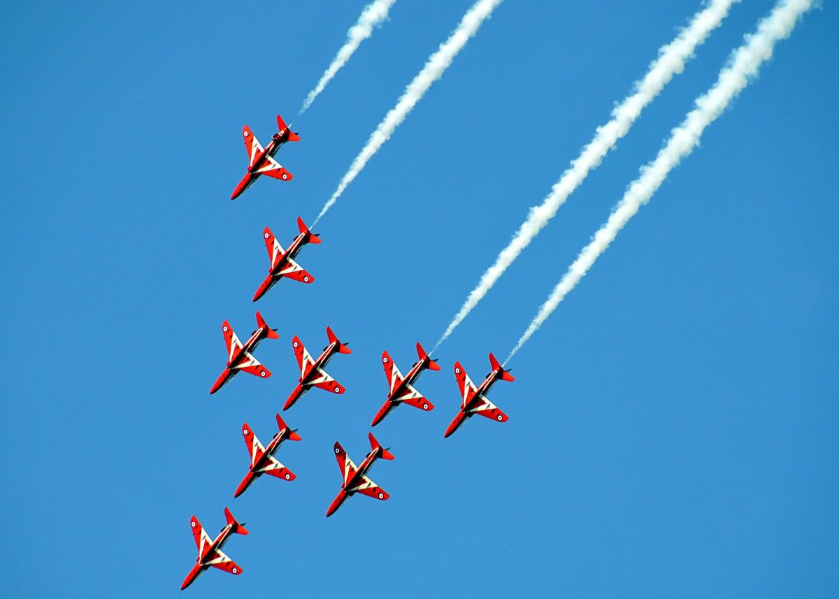 Red Arrows aeroplanes in an aerial display